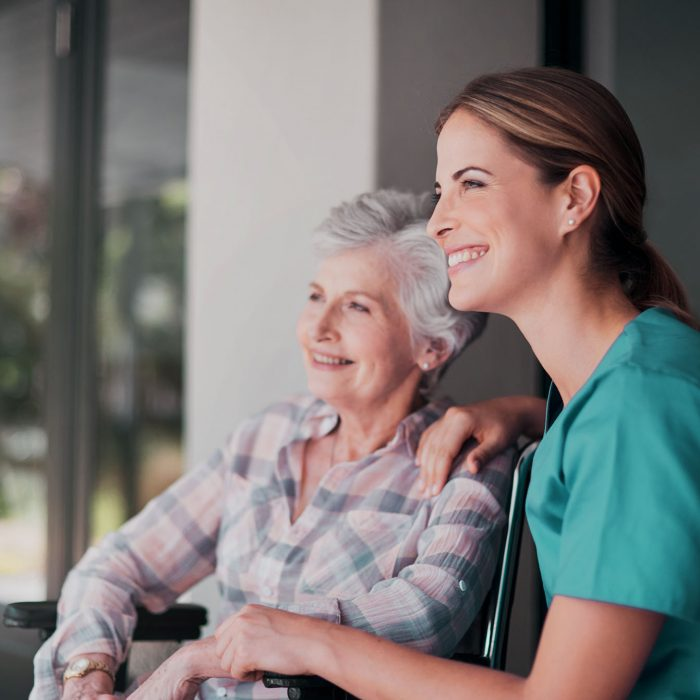 Shot of a friendly nurse bonding with her elderly patient at home